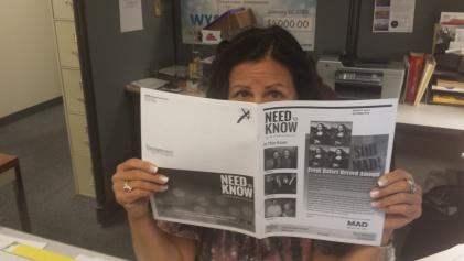 Cindy reading the spring 2015 Need to Know Newsletter