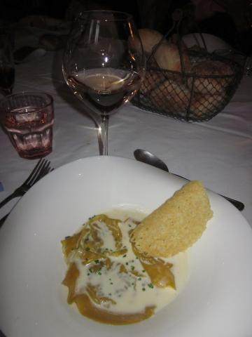 Mushroom ravioli with a cheese crisp